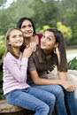 Affectionate mother and two daughters smiling Stock Photo