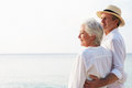 Affectionate senior couple on tropical beach holiday smiling Royalty Free Stock Photography