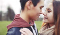 Affectionate young couple on a date close up image of romantic in park asian teenage about to kiss each other while outdoors Royalty Free Stock Photos