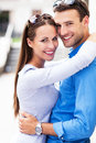 Affectionate young couple embracing smiling Royalty Free Stock Photography