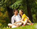 Affectionate young couple sitting in park Royalty Free Stock Images