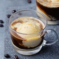 Affogato coffee with ice cream on a glass cup Grey slate background Royalty Free Stock Photo