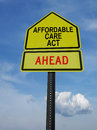 Affordable care act ahead sign conceptual with words over blue sky Stock Photos