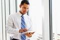 Affärsman using digital tablet Fotografering för Bildbyråer