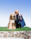 Afghan-dog and woman Royalty Free Stock Images