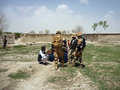 Afghan military officer interrogating locals this image presents an officers from a small village this image can be used to Royalty Free Stock Photo