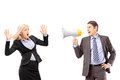 Afraid businesswoman and her manager shouting with a speakerphone isolated on white background Royalty Free Stock Photo
