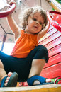 Afraid not to fall cute girl in playground being looking careful Royalty Free Stock Image