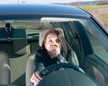 Afraid woman in the car Royalty Free Stock Photography
