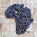 Africa continent handicraft sculpture in wood of the african with wild animals of the savanna Royalty Free Stock Photos