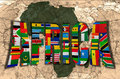 Africa the dark continent map word and flags of on background of political map of world Stock Photography