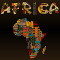 Africa map with african typography made of patchwork fabric text texture over black background Royalty Free Stock Photos