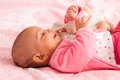 African american baby girl playing with a plush adorable little black people Stock Image