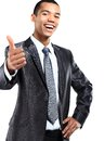 African american business man gesturing a thumbs up sign on portrait of smiling white background Stock Photos
