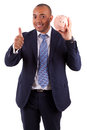 African american business man holding a piggy bank making thumbs up isolated on white background people Royalty Free Stock Photos