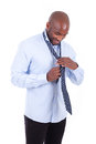 African american business man knotting a tie portrait of young black people isolated on white background Stock Photos