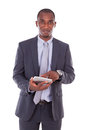 African american business man using a tactile tablet over white background black people Royalty Free Stock Images
