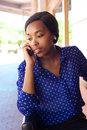African american business woman listening to cell phone Royalty Free Stock Photo