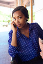 African american business woman listening to mobile phone Royalty Free Stock Photo