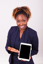African american business woman showing a tactile tablet isolated on grey background Royalty Free Stock Photo