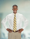 African american businessman with hands on hips young akimbo inside office building Royalty Free Stock Photo