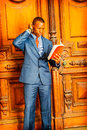 African American Businessman reading red book.