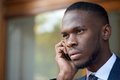 stock image of  African american businessman talking on cell phone