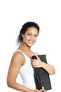 African american businesswoman or student holding a large black leather folder to her chest while smiling at the camera isolated Stock Image