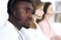 African american call operator in headset. Call center business or customer service concept Royalty Free Stock Photo