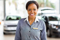 African american car saleswoman portrait of standing at dealership Royalty Free Stock Photos