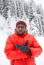 African American Cheerful black man in ski suit in snowy winter outdoors, Almaty, Kazakhstan Royalty Free Stock Photo