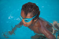 African American child with goggles in the pool Royalty Free Stock Photo