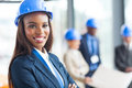 African american construction worker pretty female in office Royalty Free Stock Photos