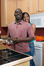 African American Couple Hugging in the Kitchen Royalty Free Stock Photography
