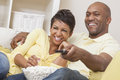 African American Couple Watching Television Royalty Free Stock Image