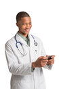 African American Doctor Texting on Smart Phone Stock Photography