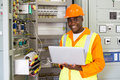 African american electrical engineer cheerful working on laptop Stock Photo