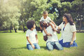 African American family alongside with Asian mum being playful and having good times in the park Royalty Free Stock Photo