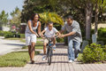 African American Family WIth Boy Riding Bike & Happy Parents Royalty Free Stock Photo