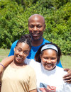African american family consisting of father mother and adolescent daughter mother has cerebral palsy Royalty Free Stock Photos
