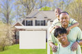 African american family in front of blank real estate sign and h new house ready for your own text Stock Image