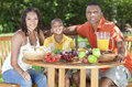 African American Family Healthy Eating Outside Stock Photo