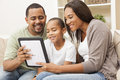 African American Family Using Tablet Computer Royalty Free Stock Photo