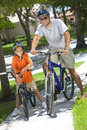 African American Father and Son Riding Bikes Royalty Free Stock Photography