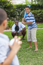 African american father sons playing baseball family man boy children two together outside Royalty Free Stock Image