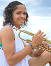 African american female beauty holding her trumpet outside Royalty Free Stock Photography