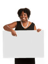 African american female holding blank board happy smiling isolated on white background Stock Photo