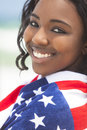 African American Girl in American Flag on Beach Royalty Free Stock Photos