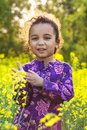 African American Girl Child in Field of Yellow Flowers Royalty Free Stock Photo