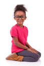 African American girl seated on the floor Stock Photo